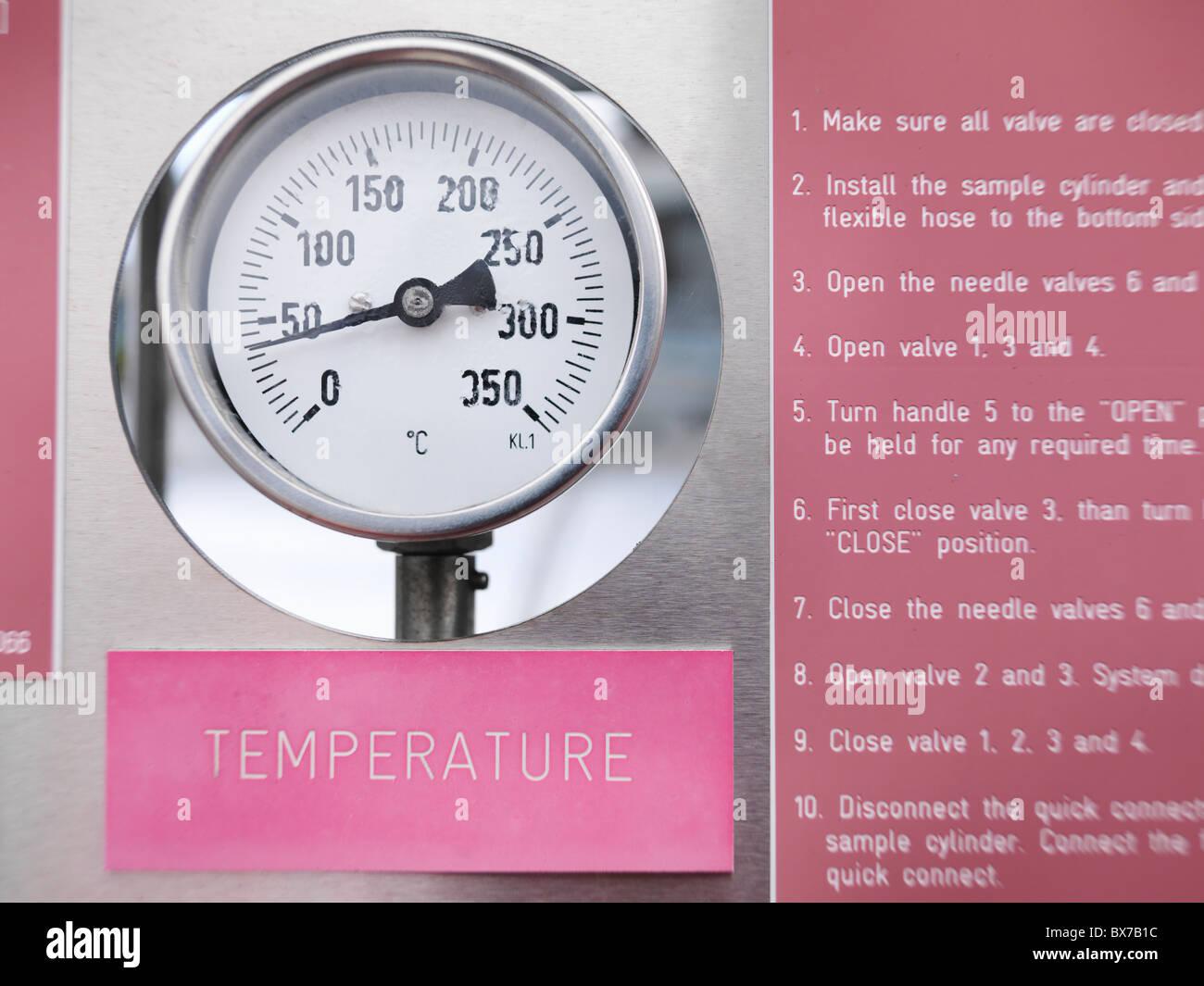 Temperature gauge at gas storage plant - Stock Image