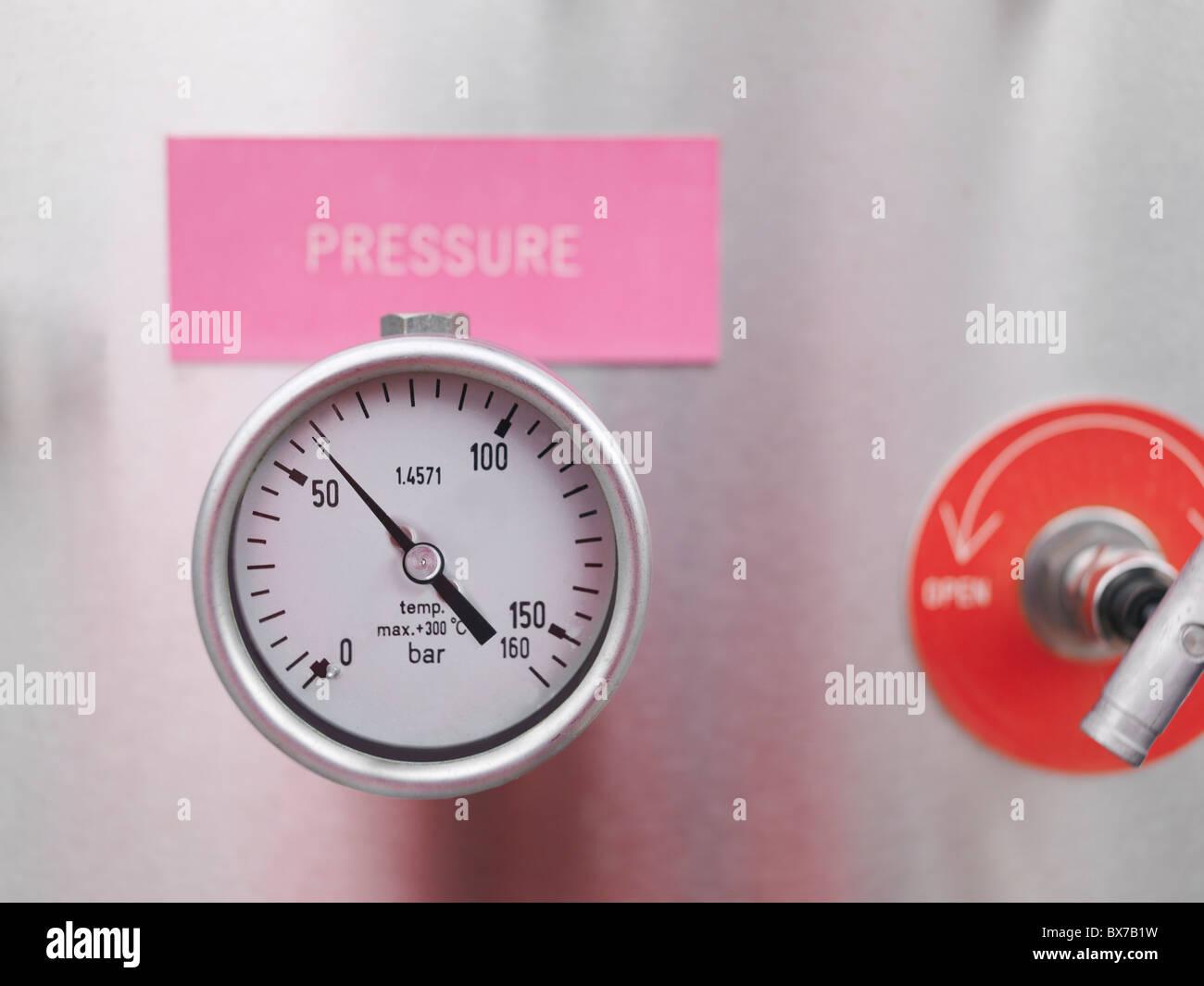 Pressure gauge at gas storage plant - Stock Image