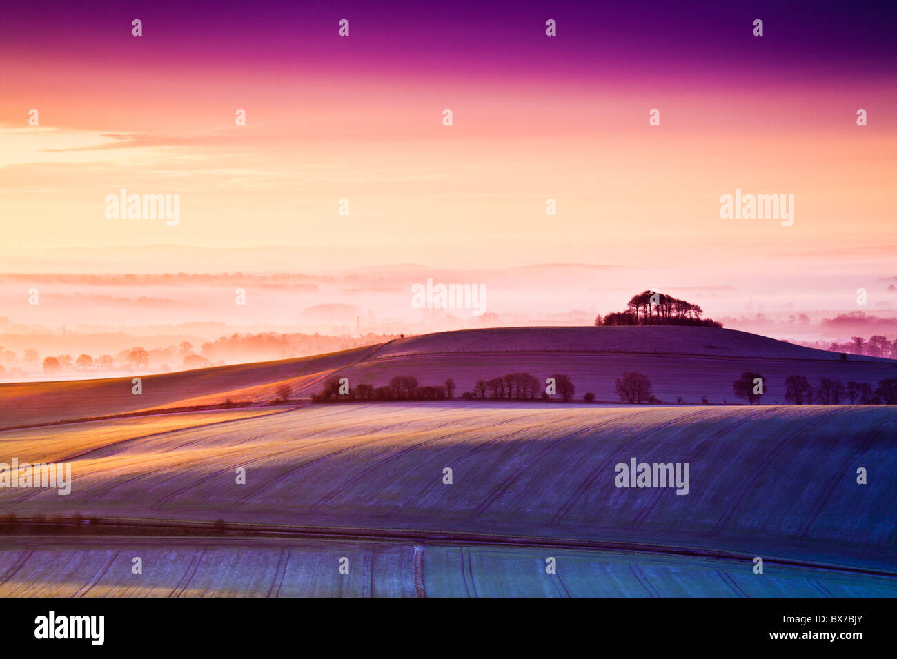Frosty winter sunrise from Walker's Hill over the Vale of Pewsey in Wiltshire, England, UK - Stock Image