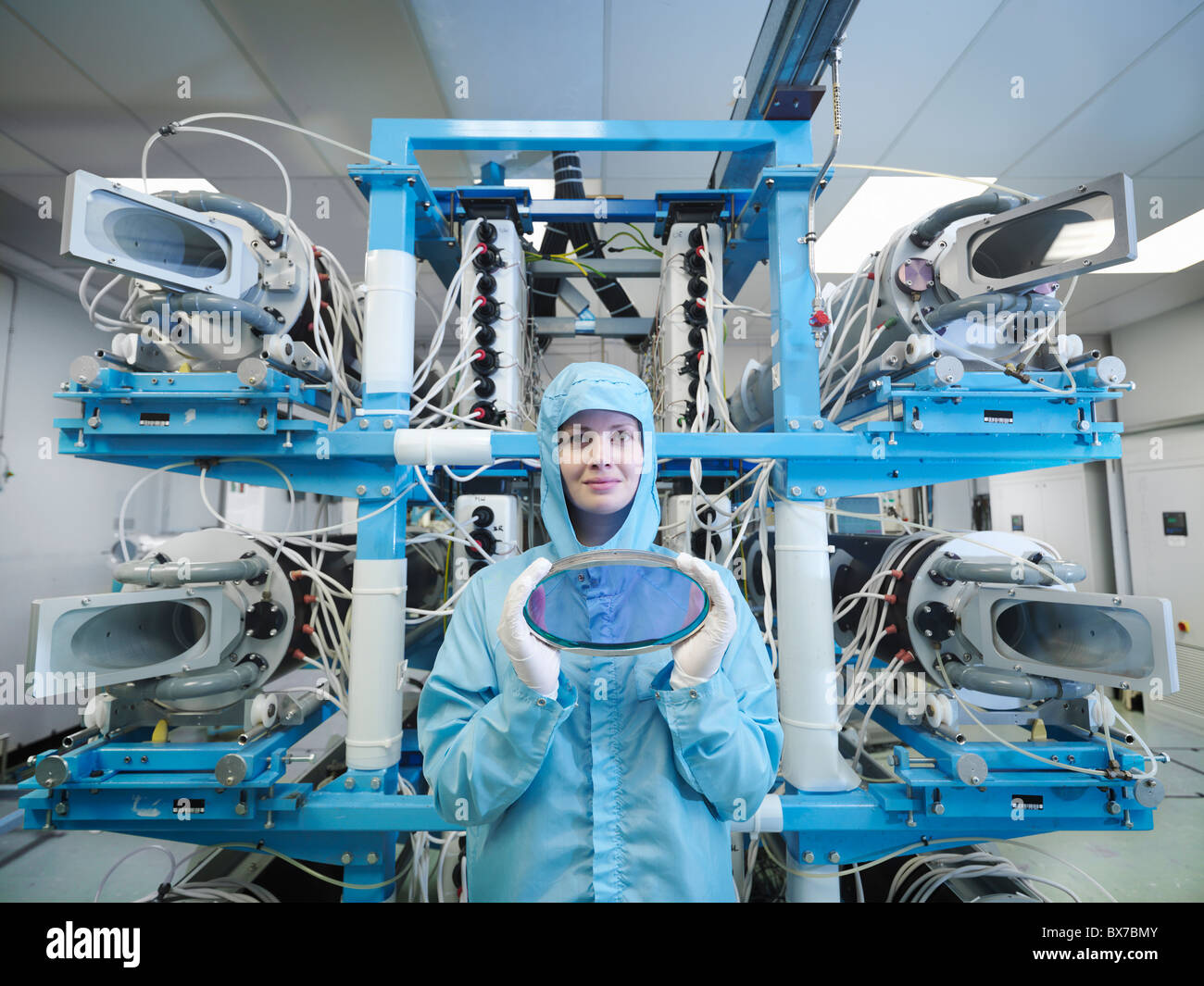 Scientist with filter and laser lens - Stock Image