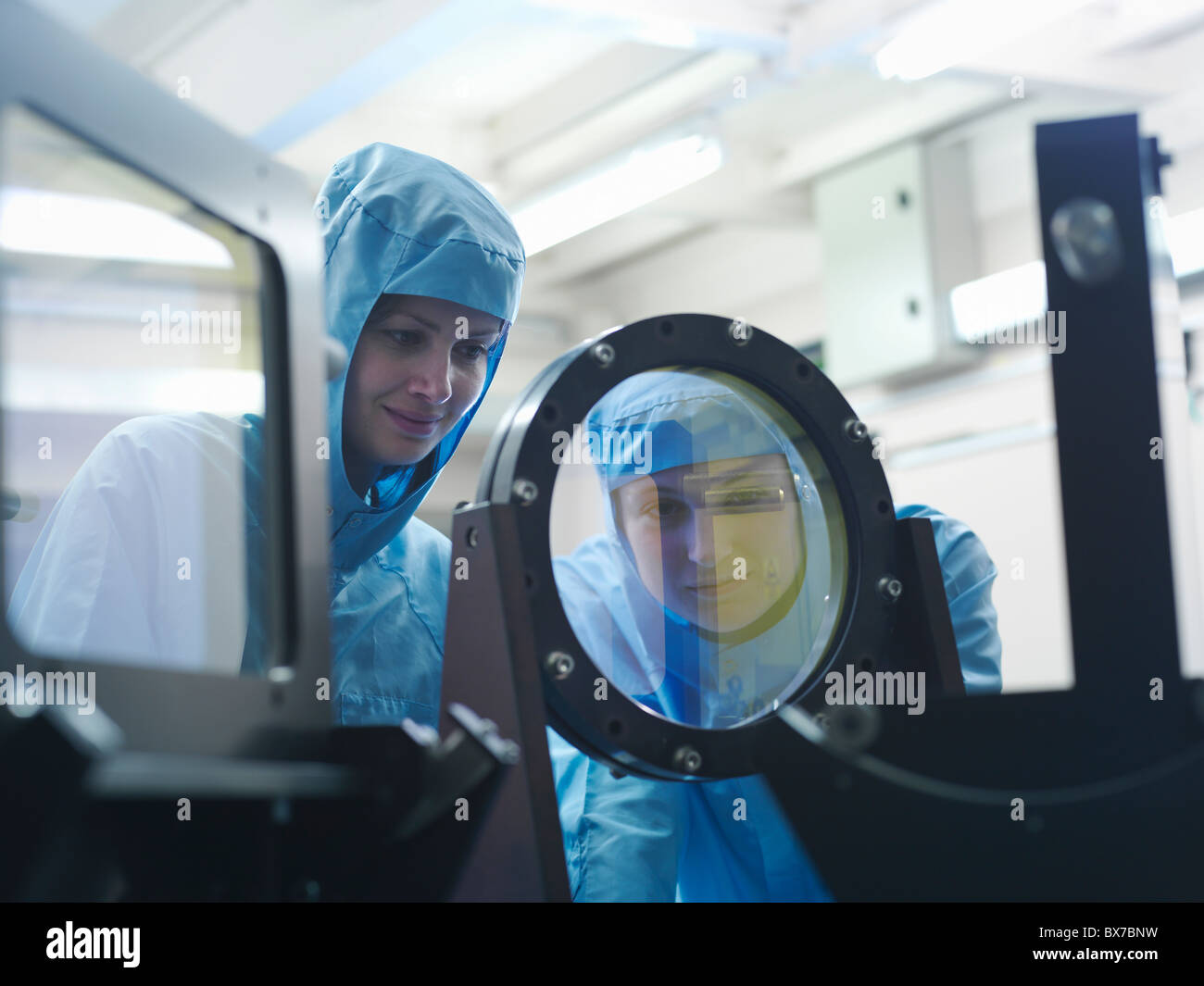 Scientists inspecting laser filter - Stock Image