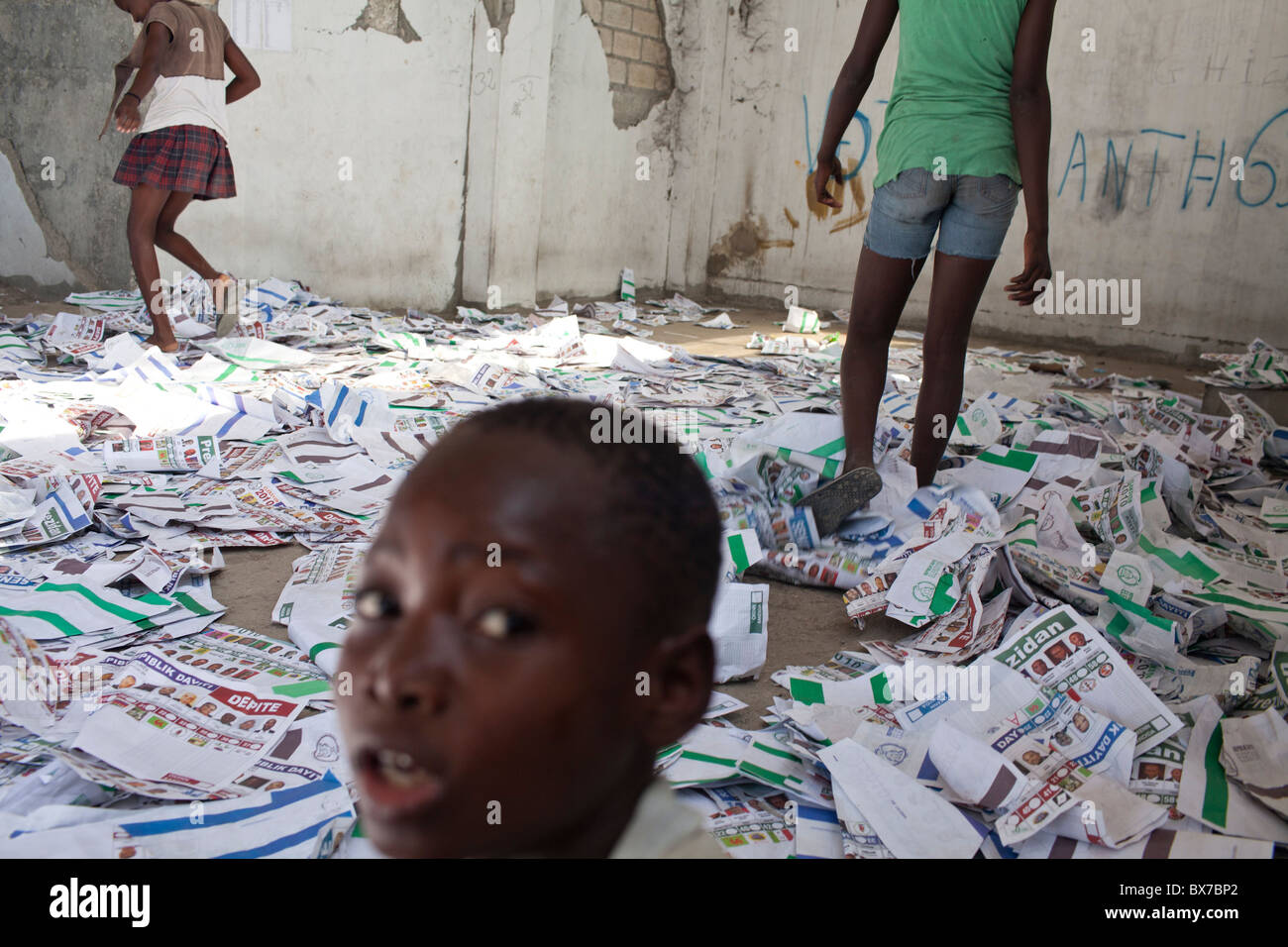 Children play in ballots at a polling station that had been ransacked on the previous day during presidential elections - Stock Image