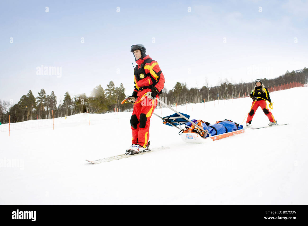 Two Rescuers in Piste - Stock Image