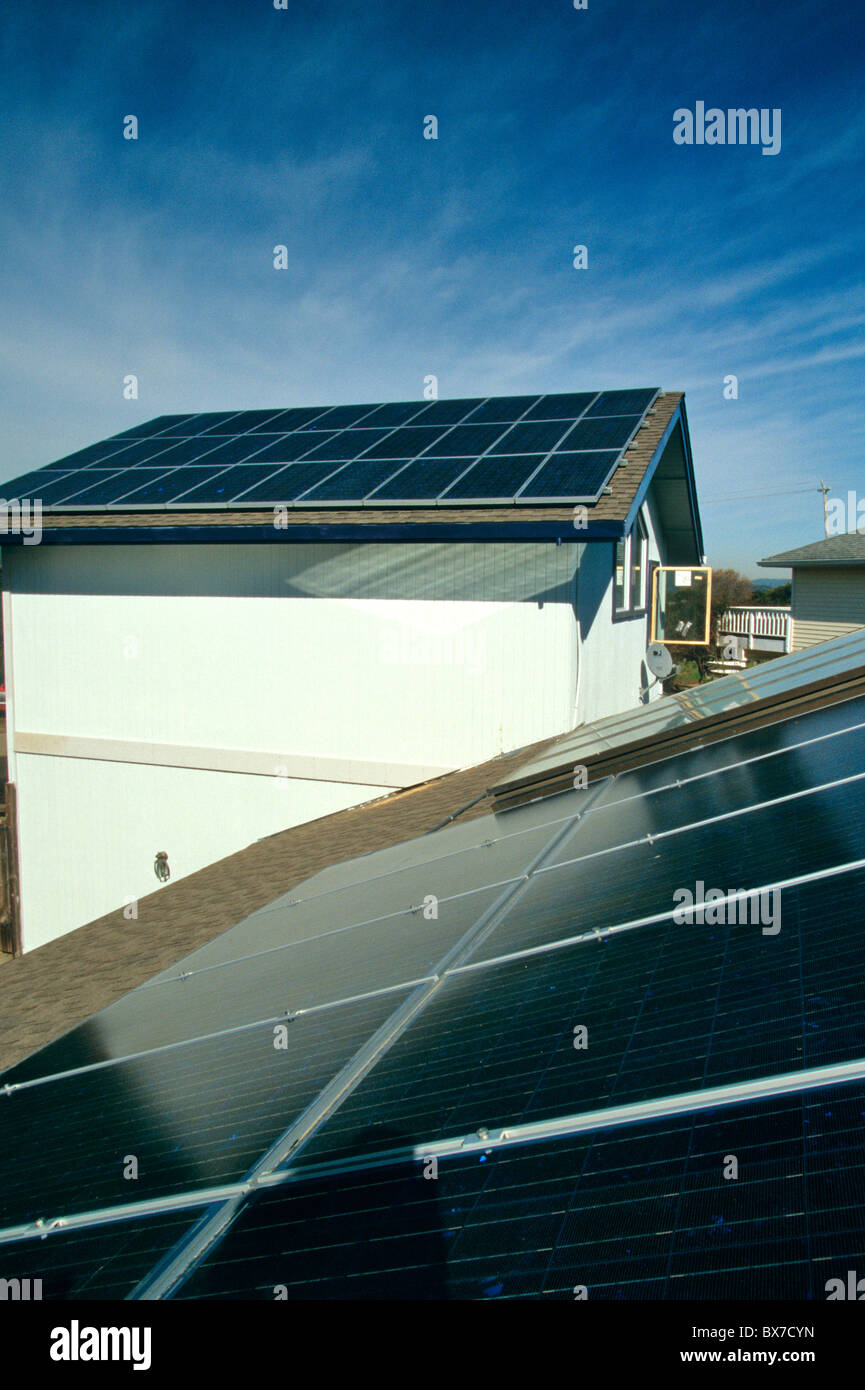 Solar Electric panels on residence roof, - Stock Image