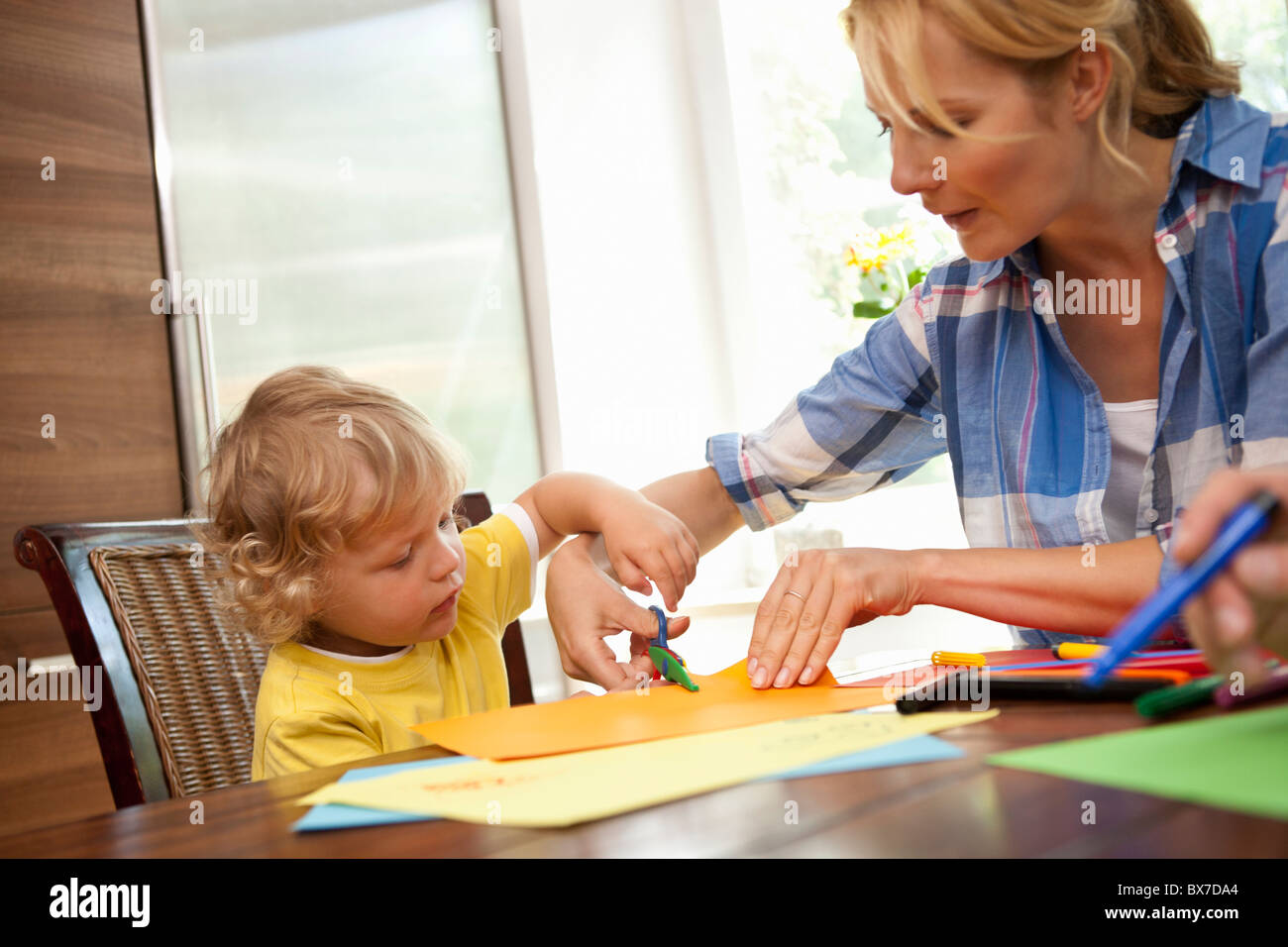 Woman doing handicraft with child - Stock Image
