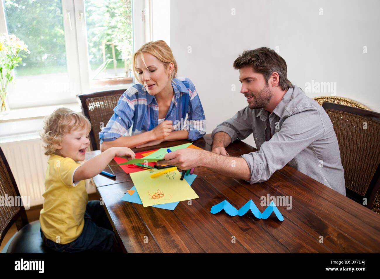 Family handcrafting on table - Stock Image