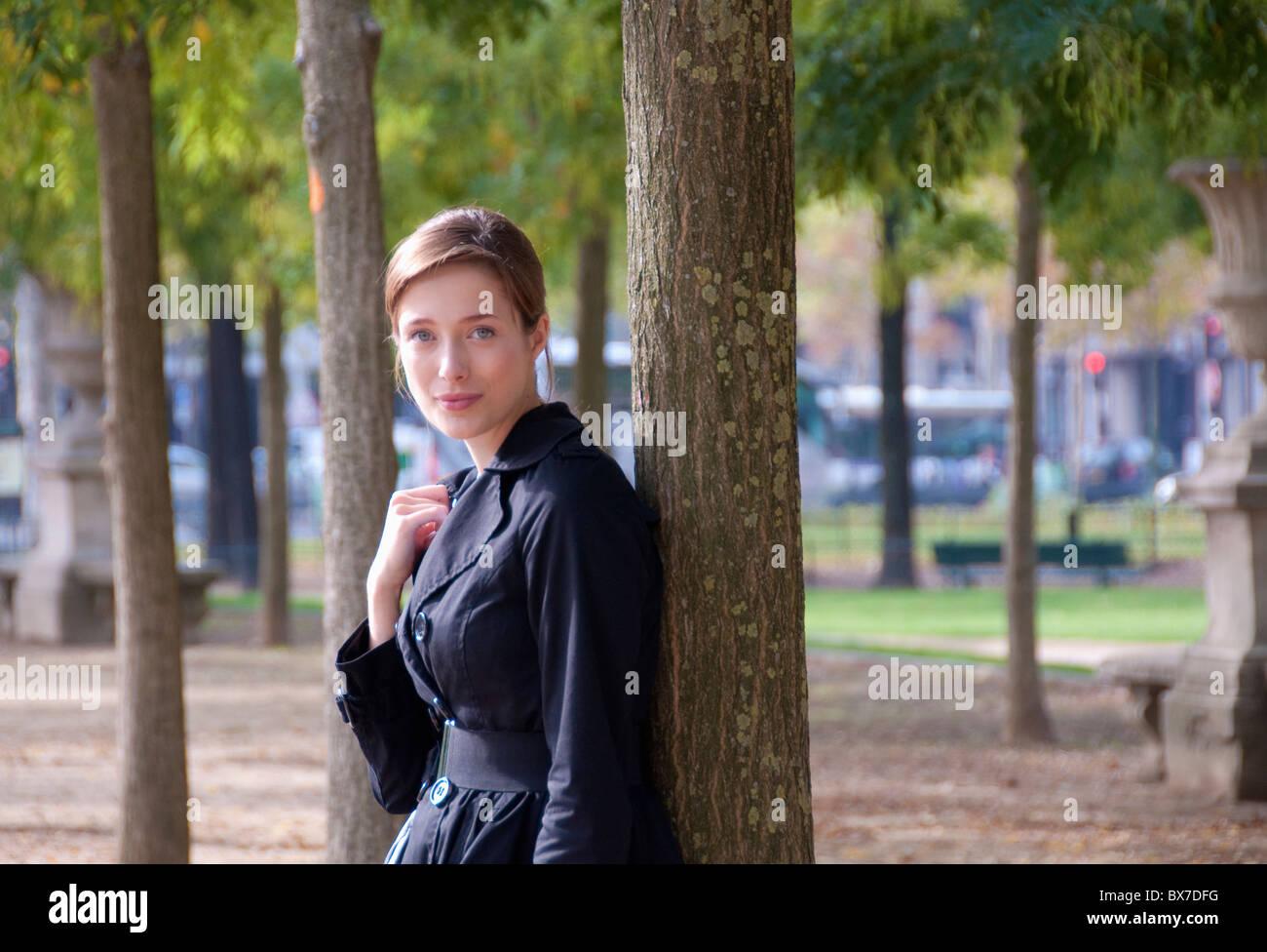 Portrait of woman in Paris park - Stock Image