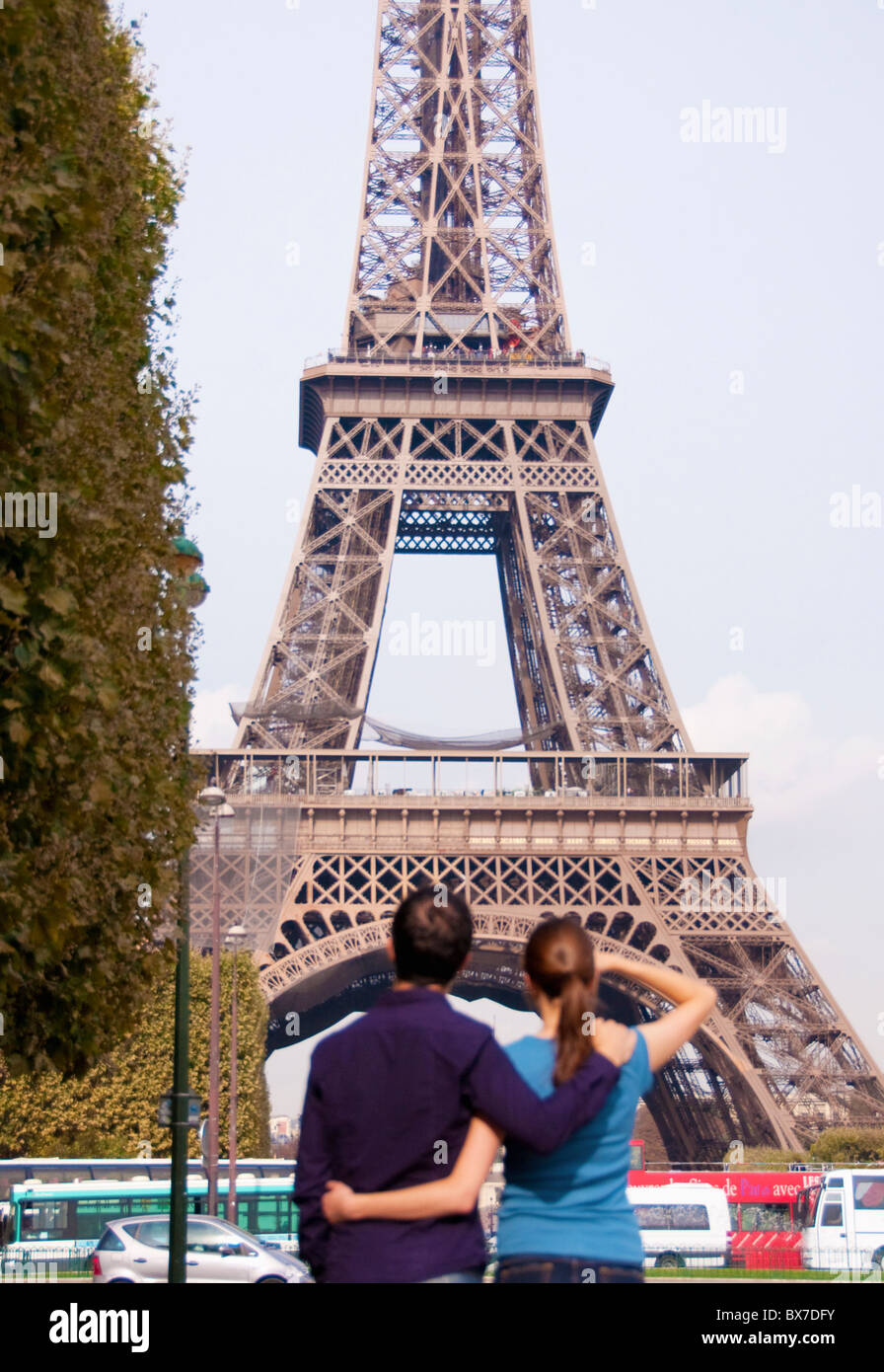 Couple look at Eiffel Tower in Paris Stock Photo