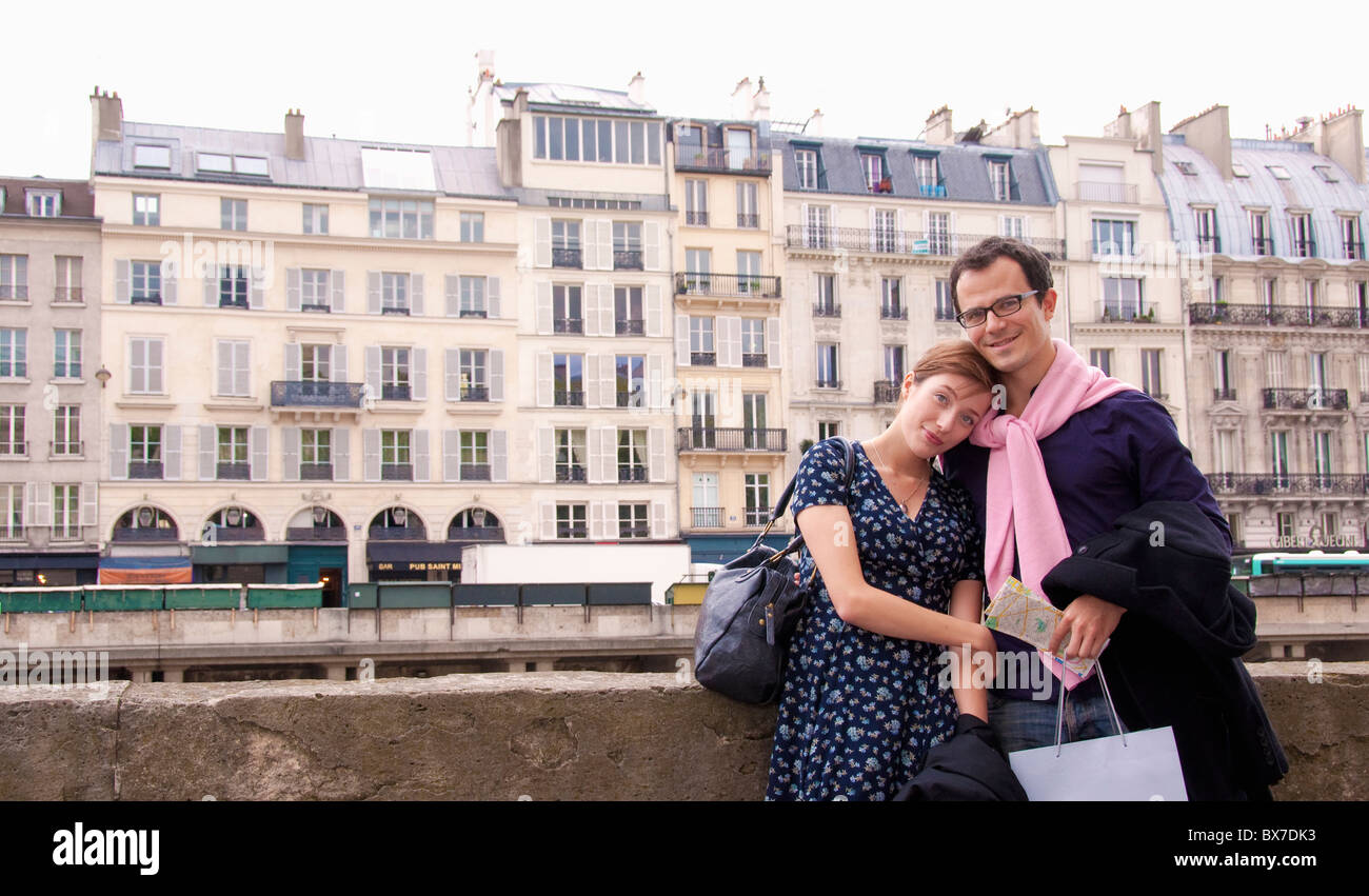 Couple embrace after shopping in Paris Stock Photo