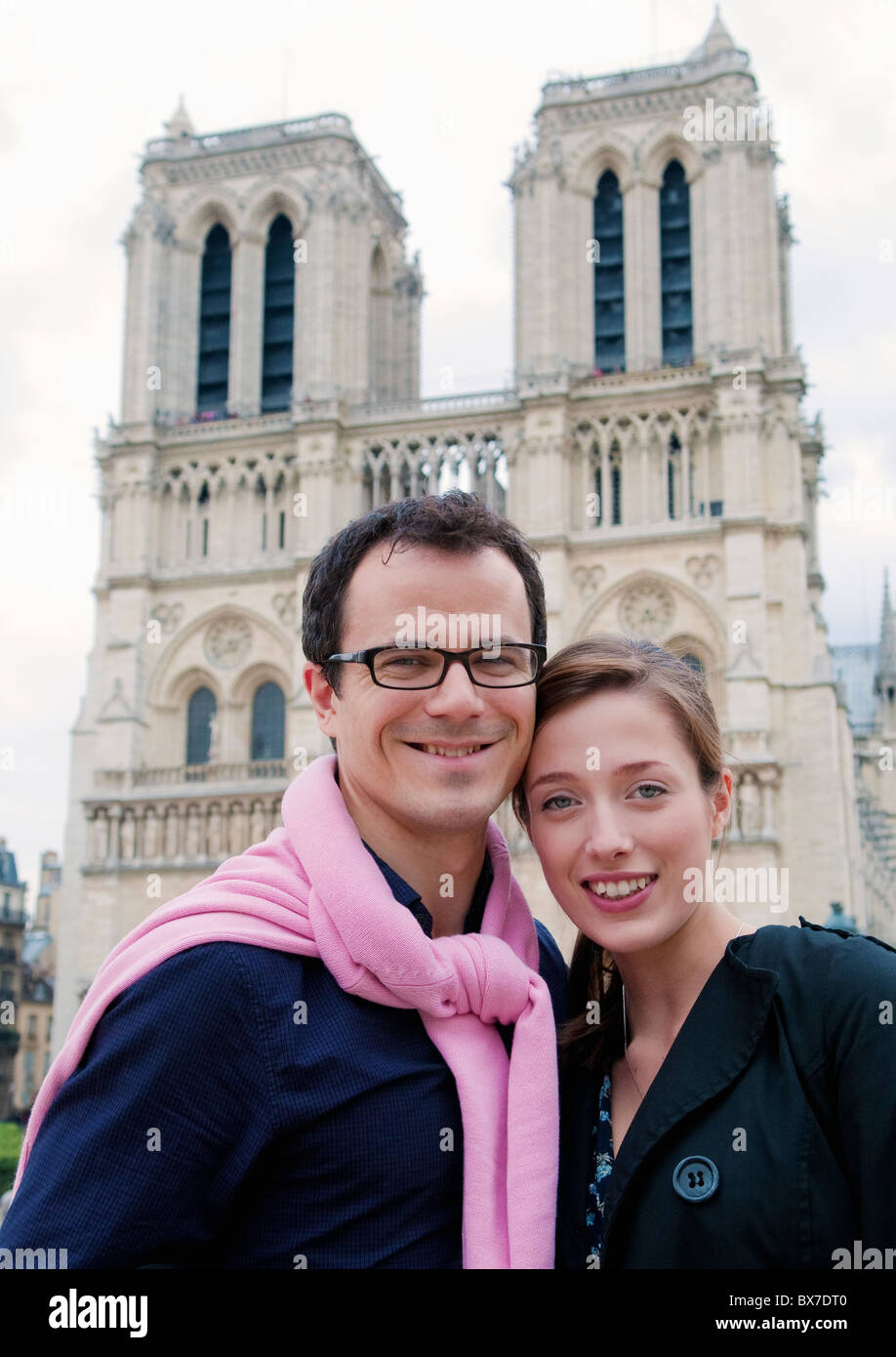Couple in front of Notre Dame Paris - Stock Image