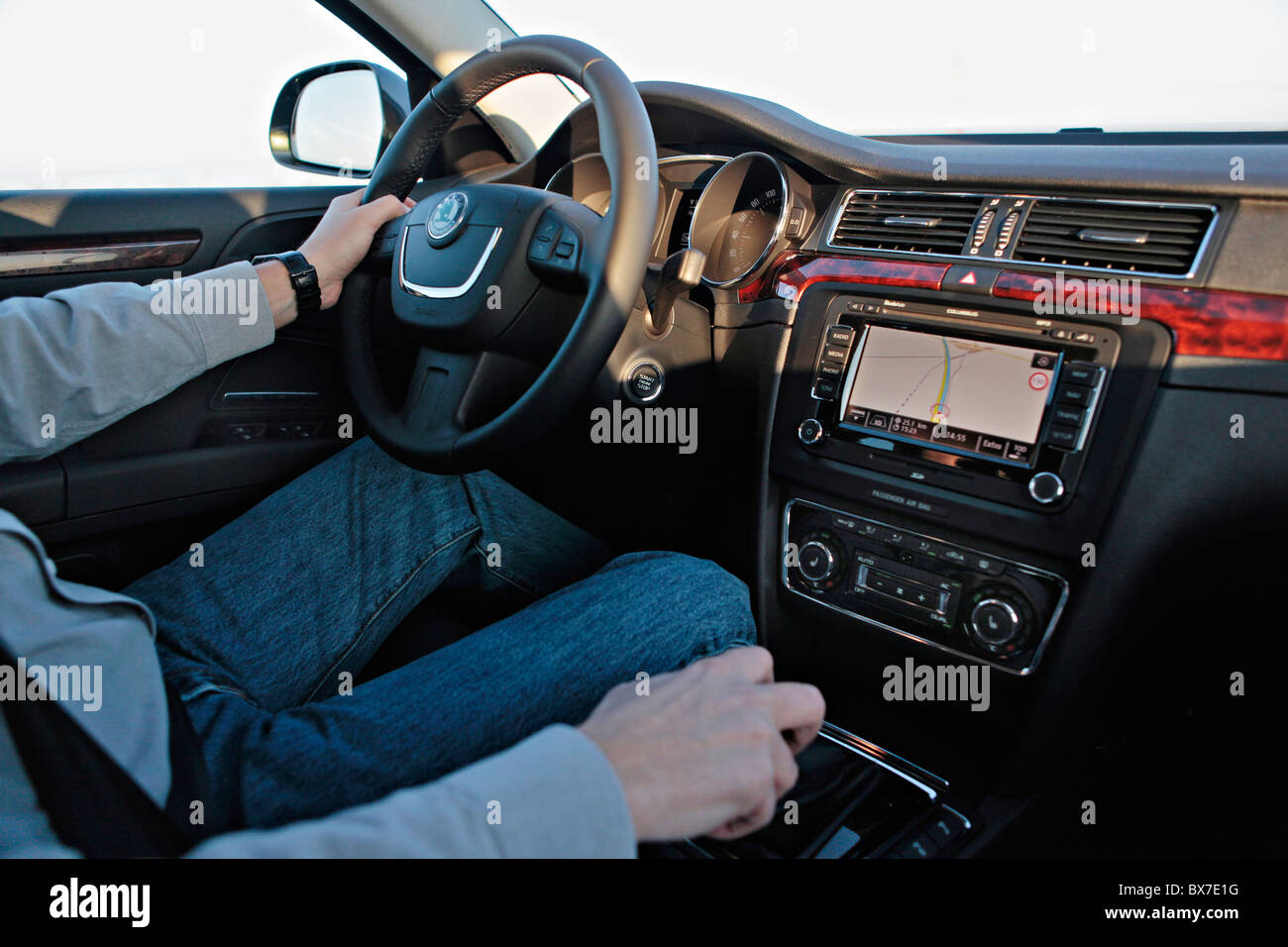 one hand driving, luxury car, built-in GPS navigation system