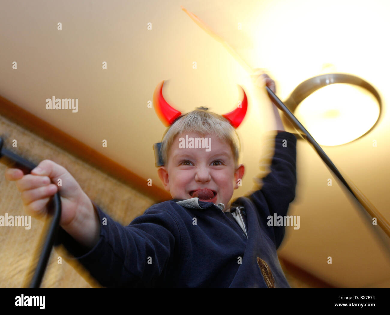 A boy as a devil with horns and trident. There's a tradition in Czech Republic that in the evening of St Nicholas - Stock Image