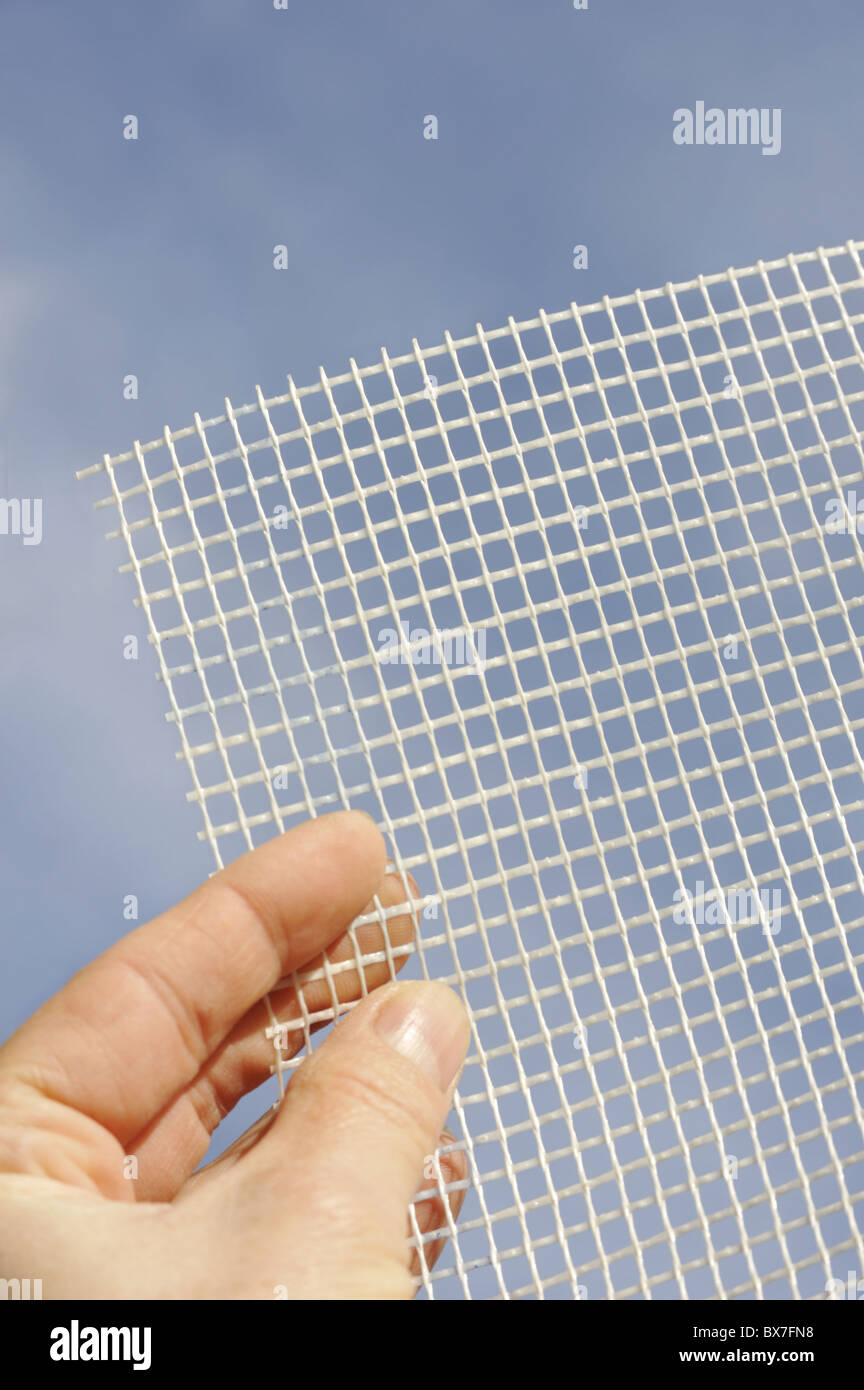 Detail of glass-fiber mesh in hand – reinforcing material