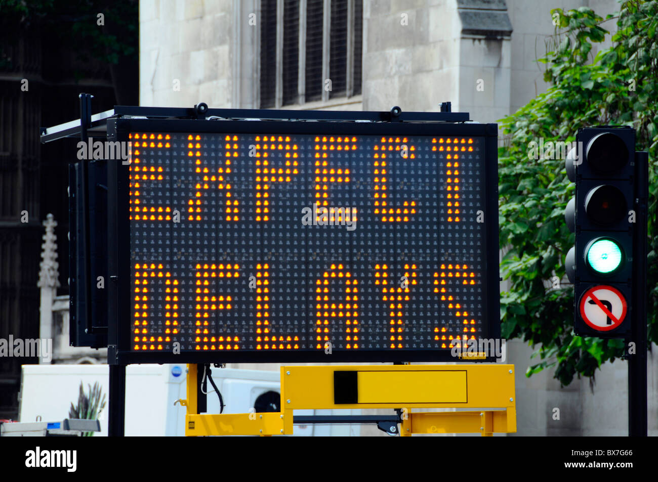Close up of temporary and portable electronic road sign warning of London traffic delays England UK - Stock Image