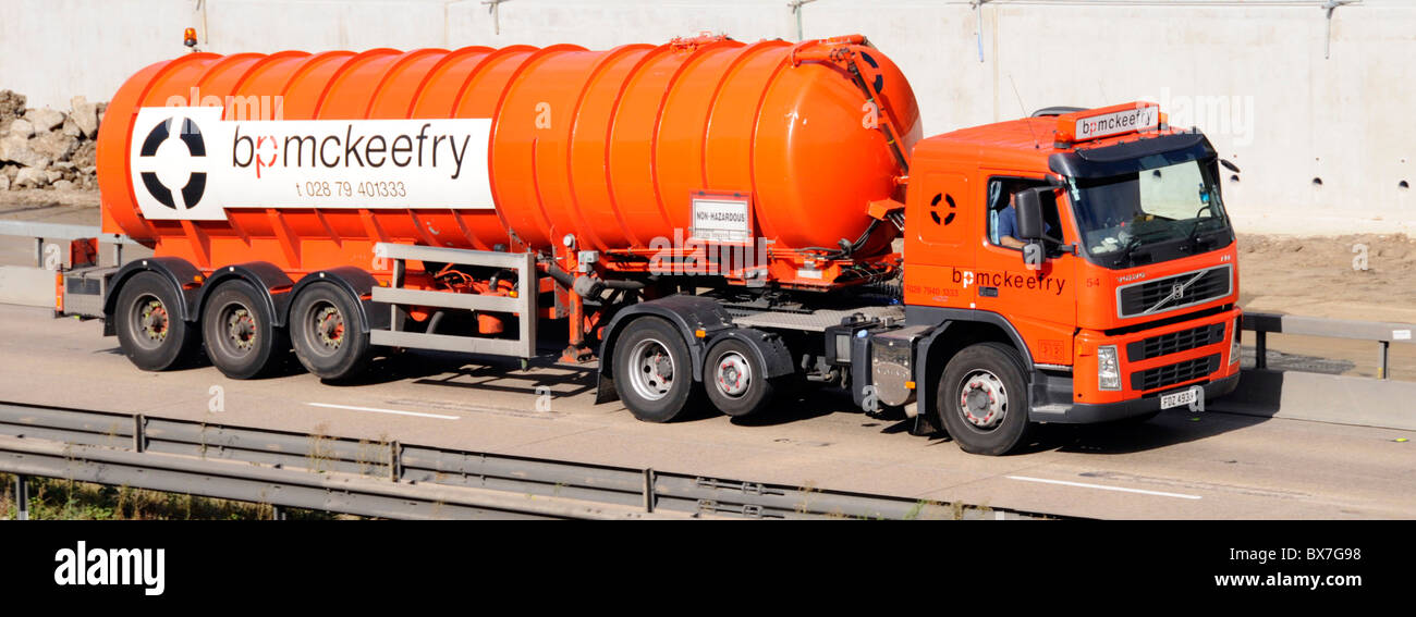 Tanker truck with raised axle tyre wear economy feature on lorry and trailer - Stock Image