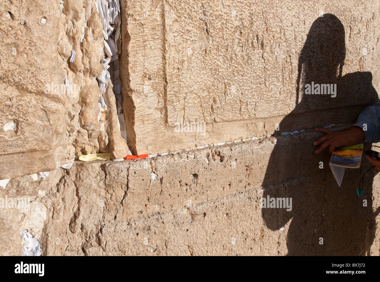 shadow of an orthodox jew praying at western wall. Jerusalem. Israel - Stock Image
