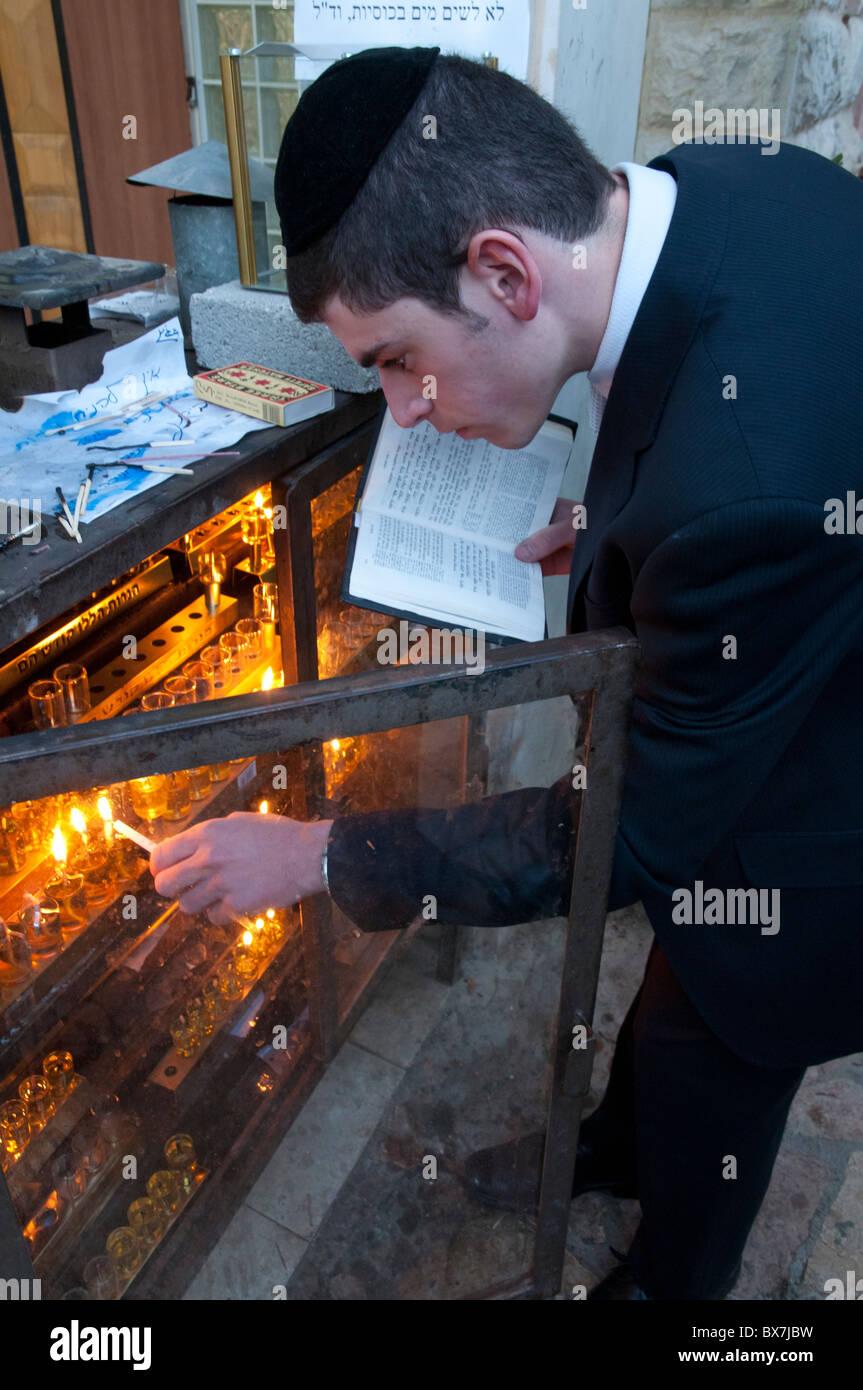 orthodox Jew lighting the hanuka candles. Jerusalem. Israel - Stock Image