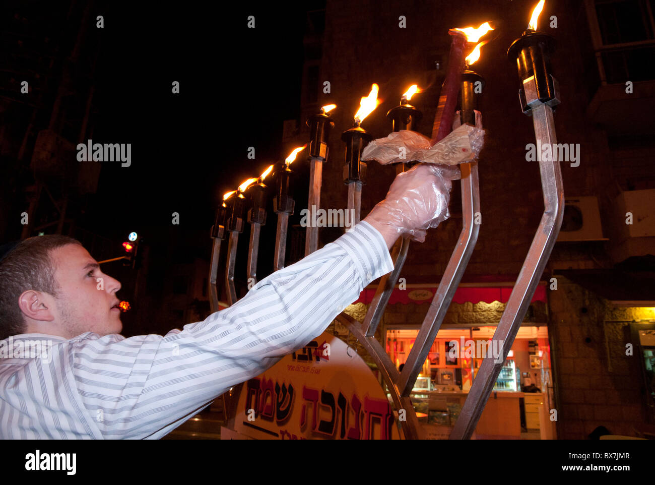Lubavitch jews lighting a street hanukiah during the Jewish Hanukah festival. Jerusalem. israel - Stock Image