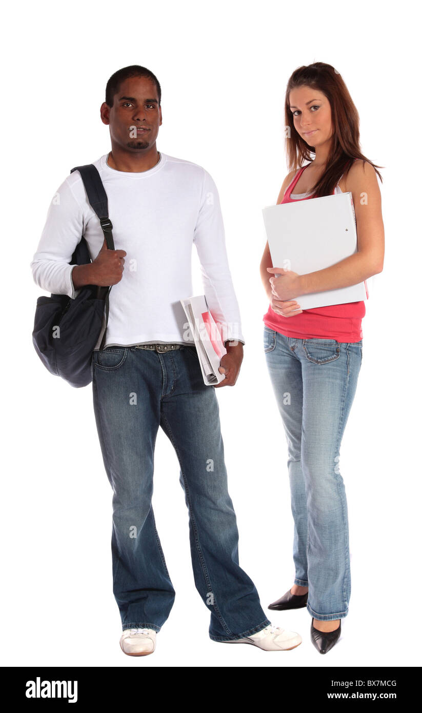 Two attractive students standing in front of plain white background. - Stock Image