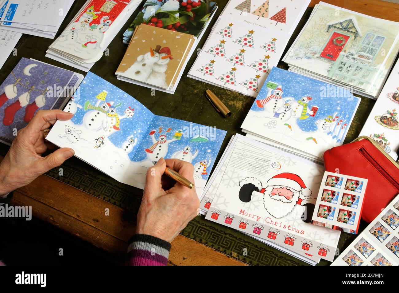 Writing festive christmas greetings cards stock photo 33361293 alamy writing festive christmas greetings cards m4hsunfo