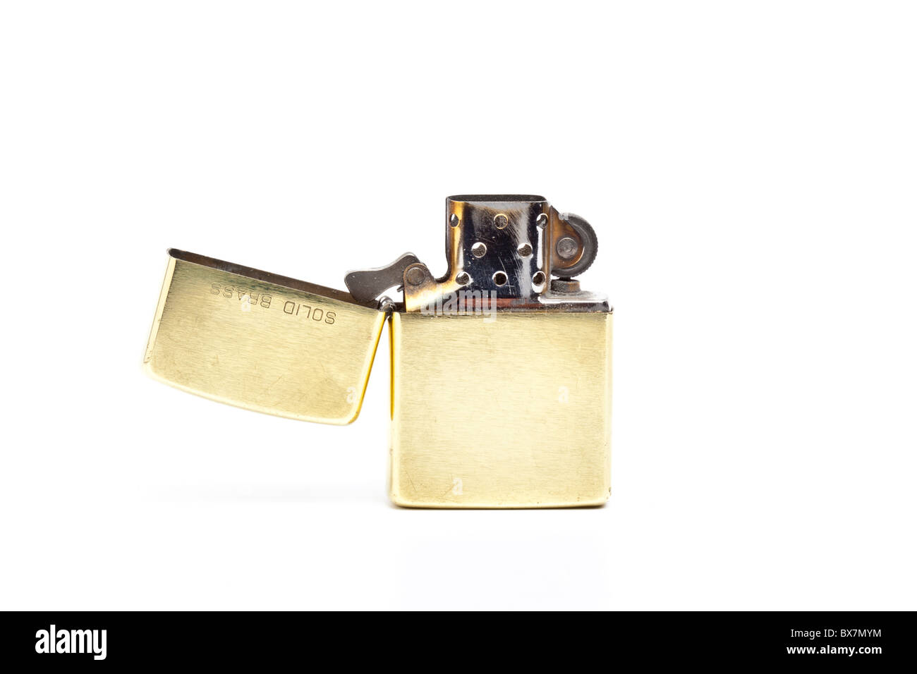 Brass Zippo lighter with open top - Stock Image