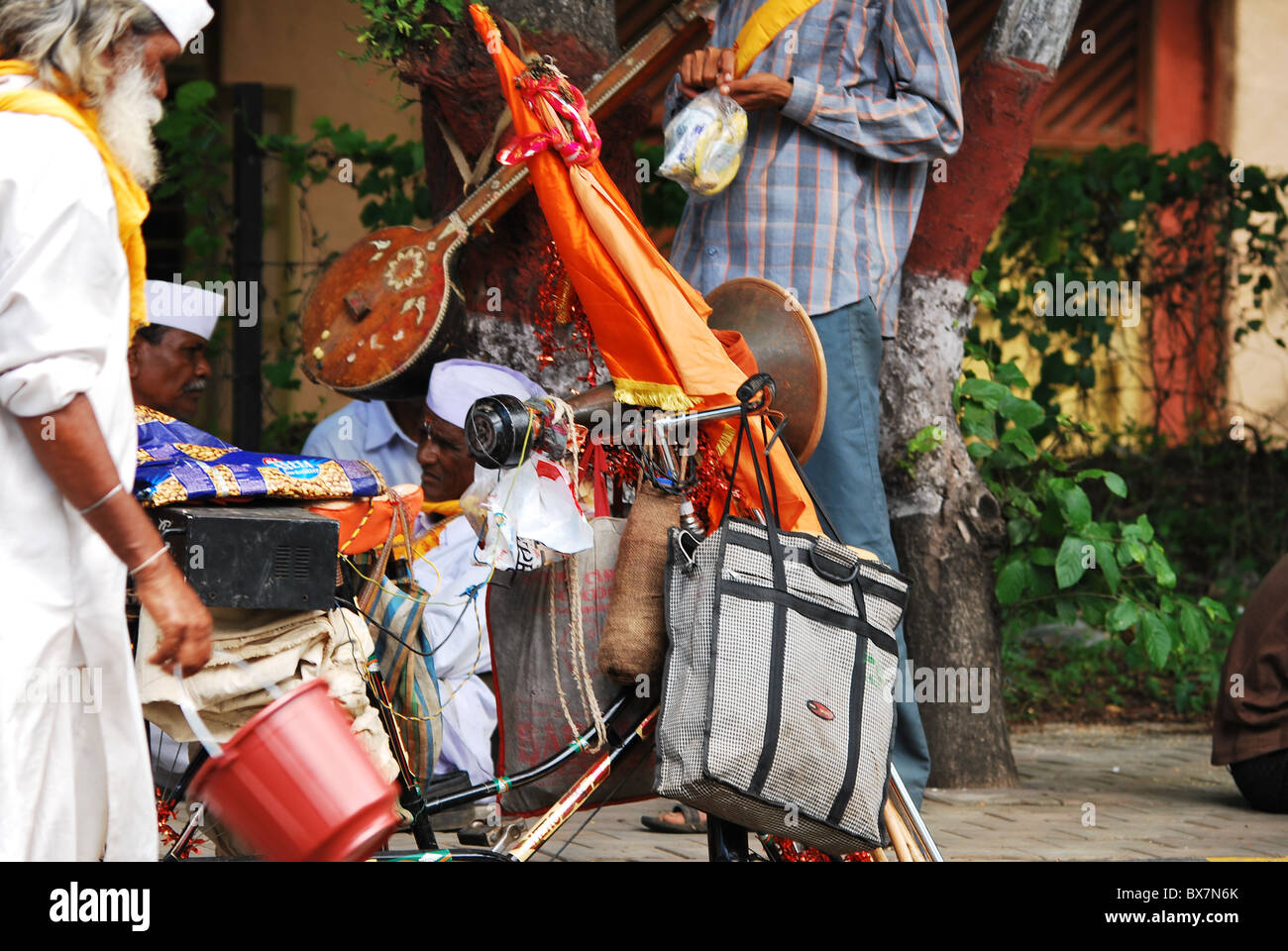 cycle with instrumental in saint dnyshwar palkhi - Stock Image