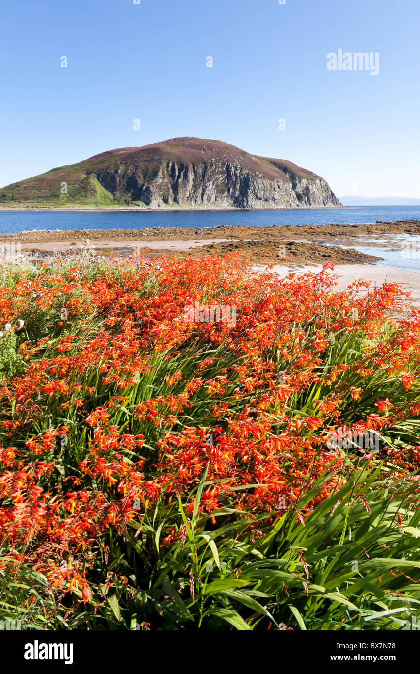 Davaar Island at the mouth of Campbeltown Loch seen across Kildalloig Bay, on the Kintyre Peninsula, Argyll & - Stock Image