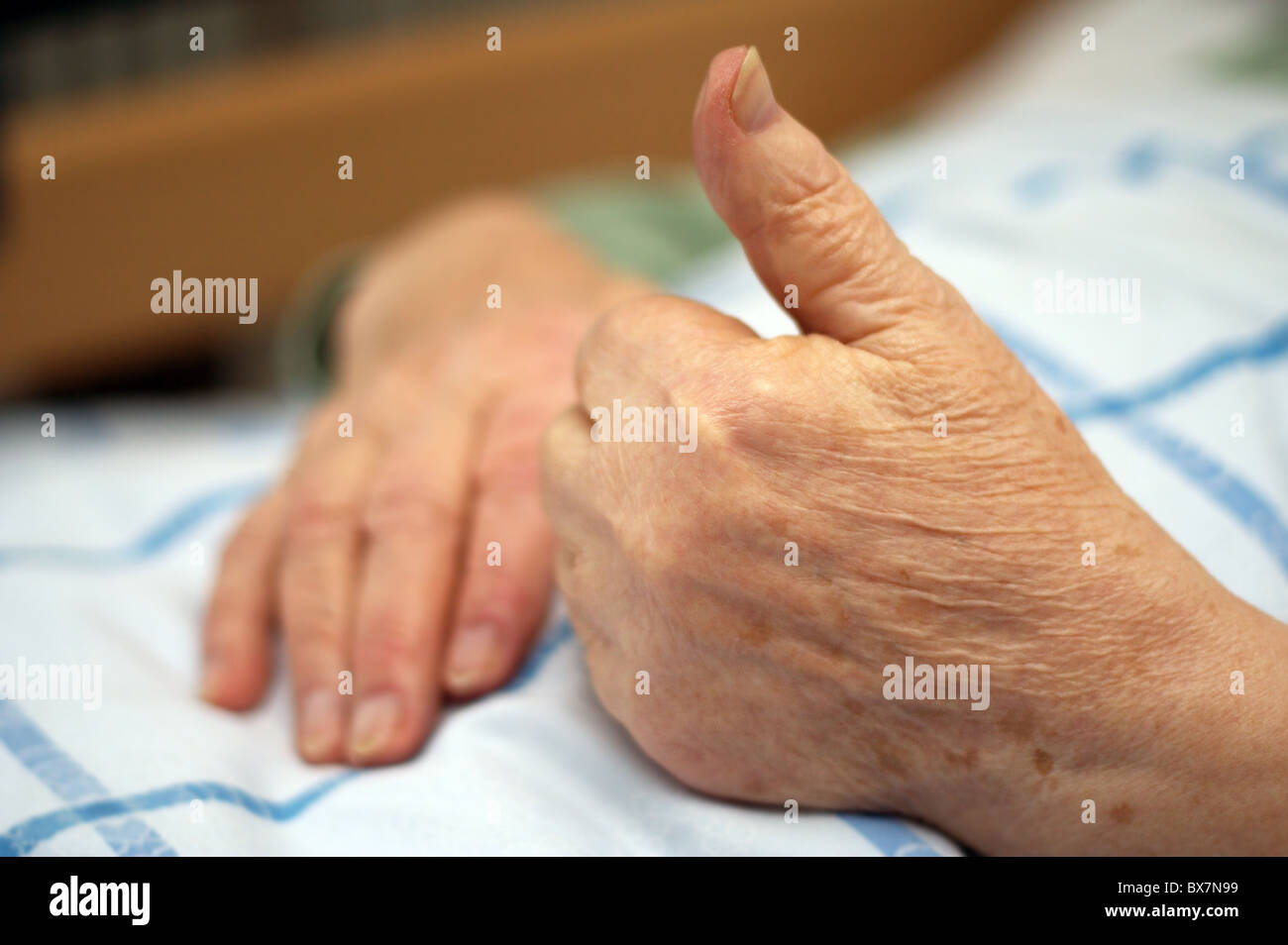 Hands of a care-dependent person making positive gesture. - Stock Image