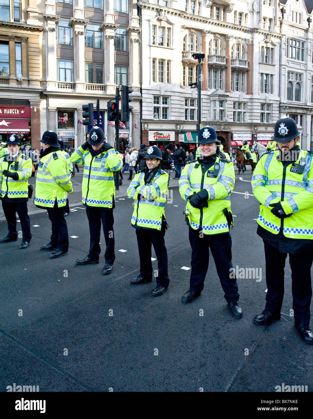 A line of Metropolitan Police Officers at a demonstration in London. - Stock Image