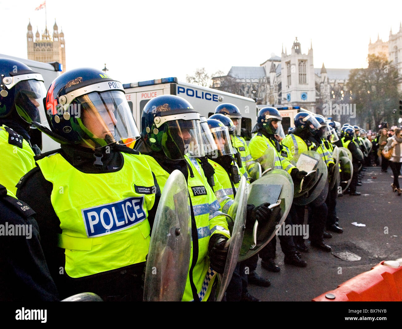 Metropolitan Police officers forming a cordon at a student demonstration in London. - Stock Image