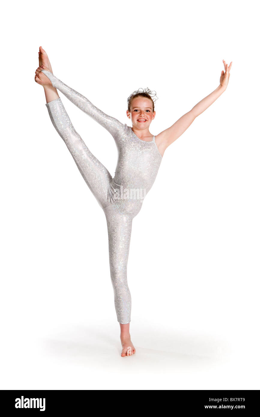 Studio shot of young dancer in silver sci-fi costume - Stock Image