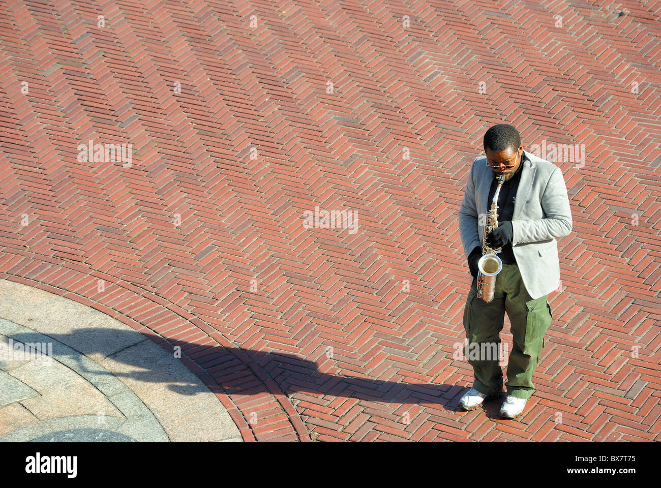 A saxophonist busking in Central Park's Bethesda Terrace. - Stock Image