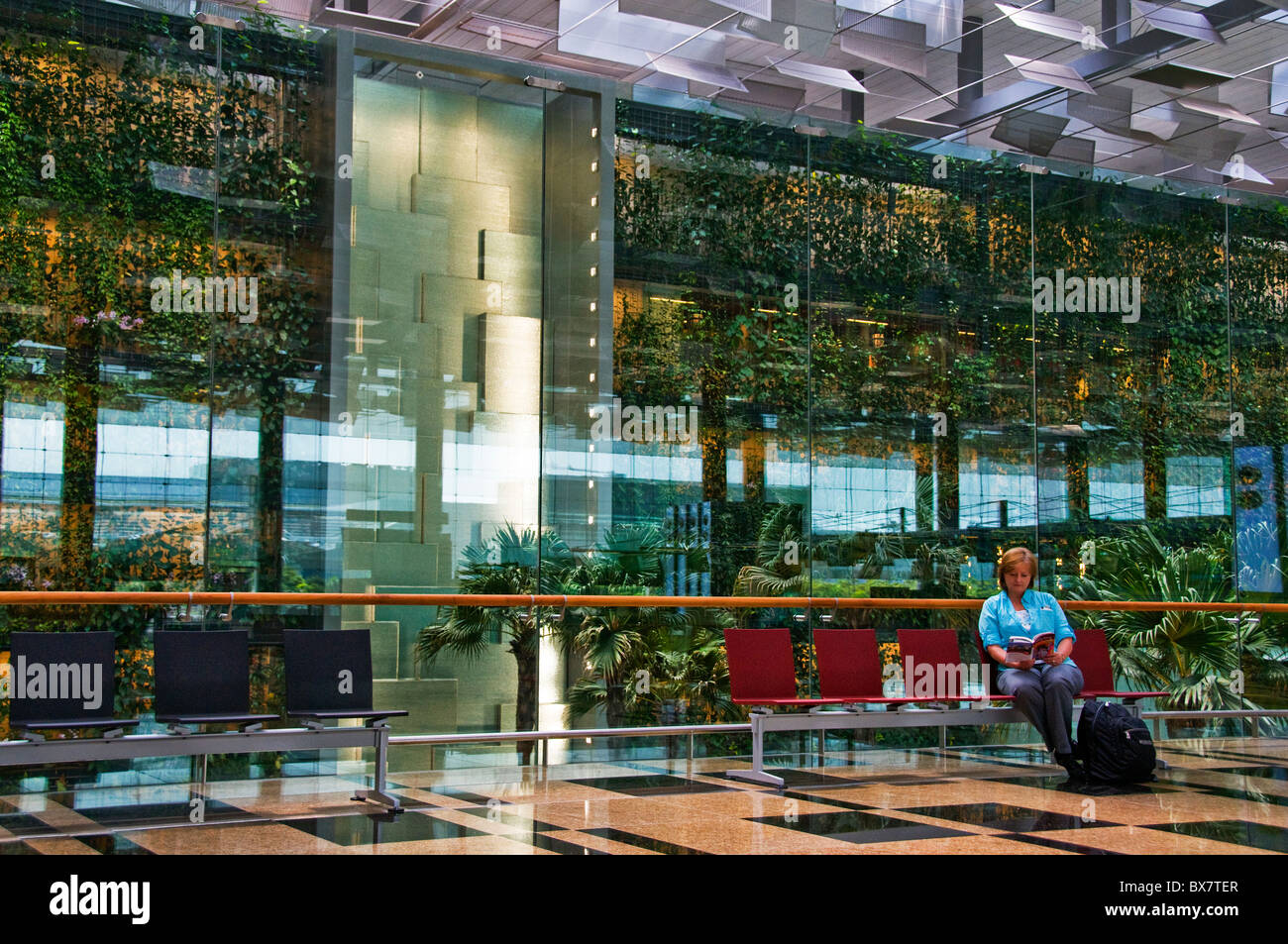 Interior of new modern Changi airport terminal in Singapore southeast Asia - Stock Image