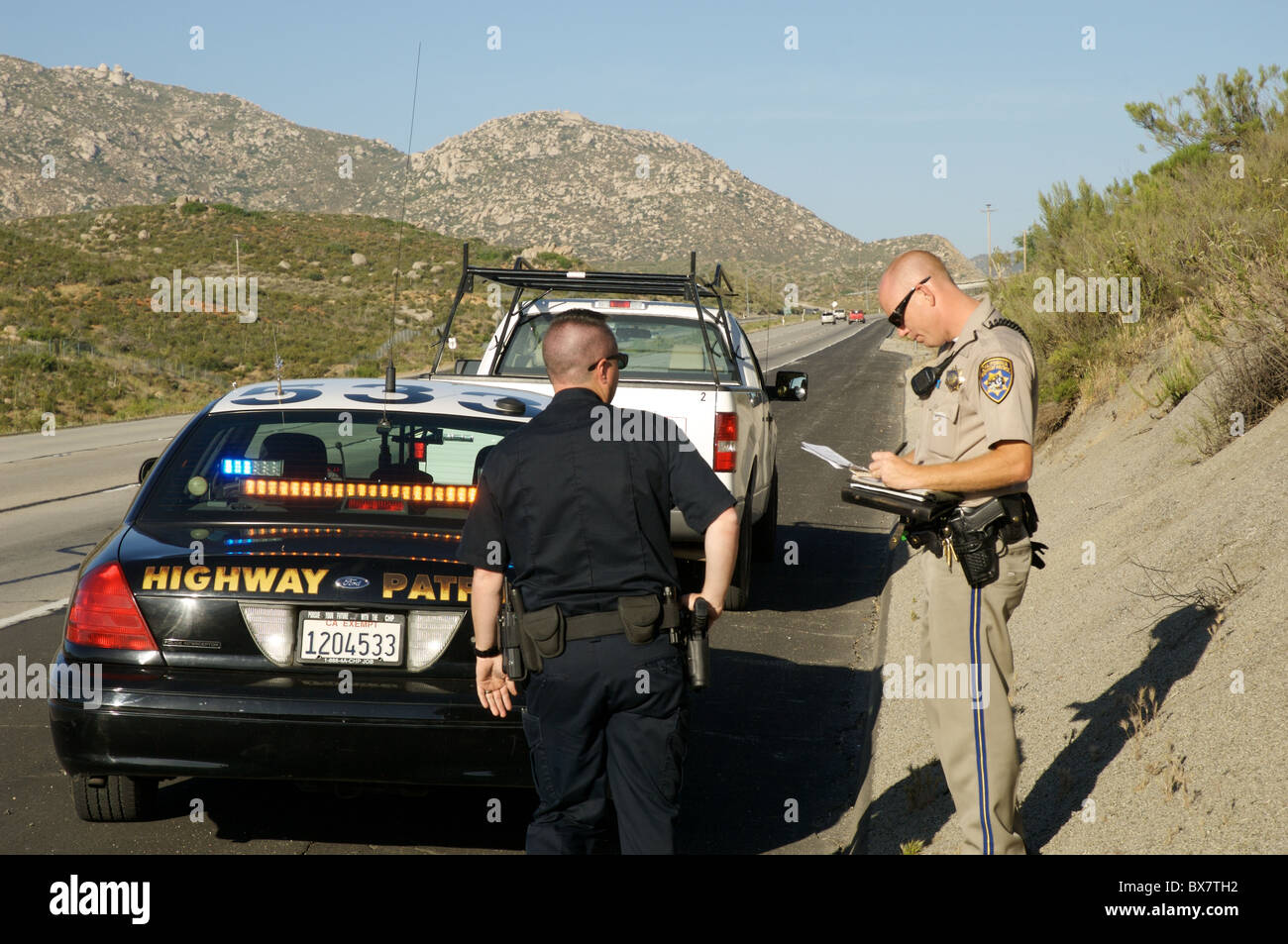 California Highway Patrol  >> A Local Police Officer Assists A California Highway Patrol Officer
