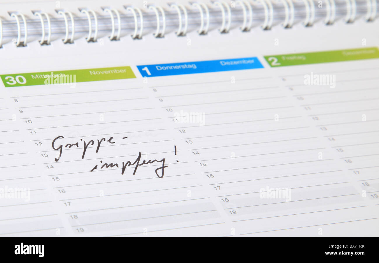 A standard schedule. The german term Grippeimpfung is marked. (english: flu jab) - Stock Image