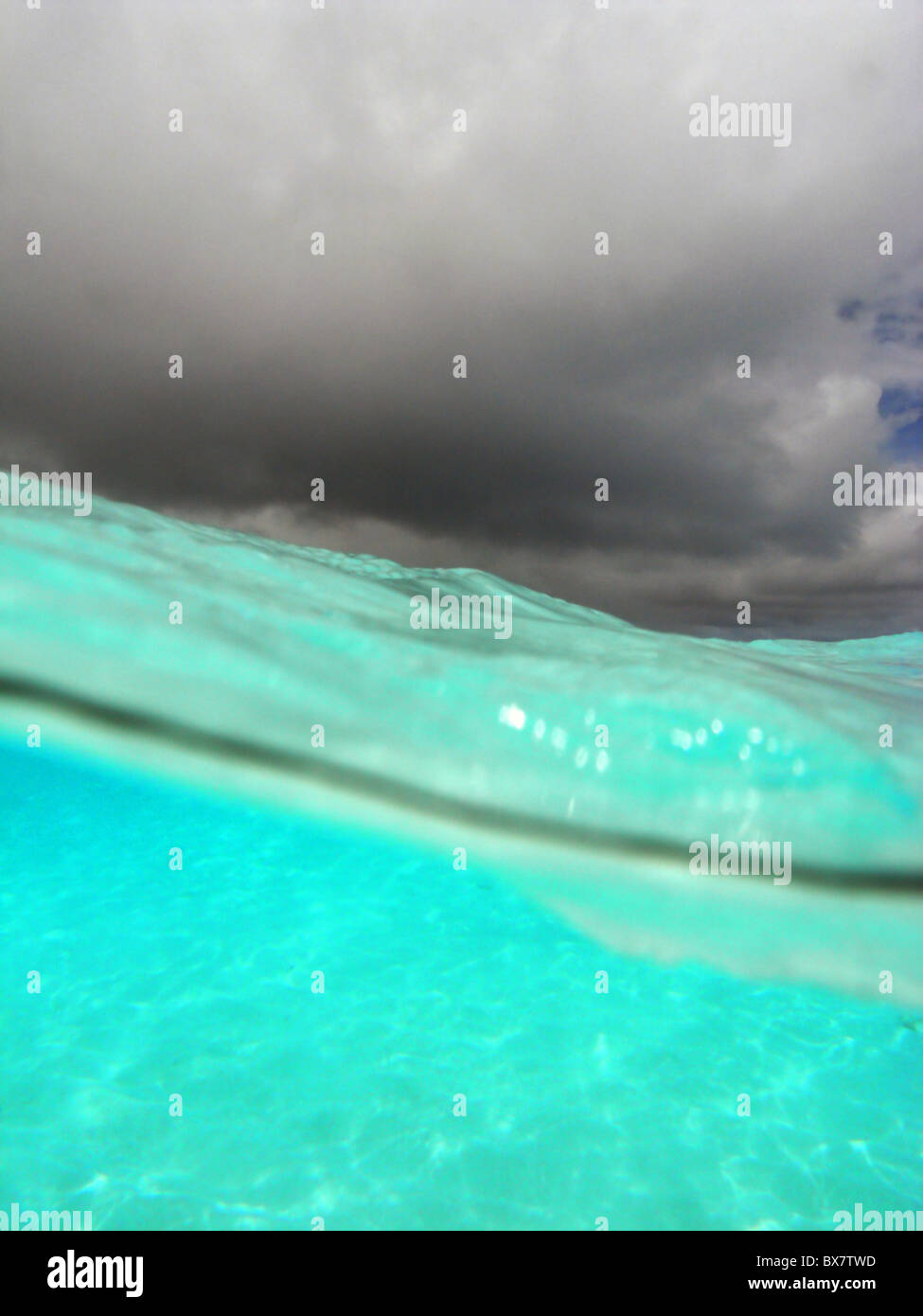 Crystalline lagoon waters and monsoon clouds over Cocos Keeling atoll, Indian Ocean - Stock Image