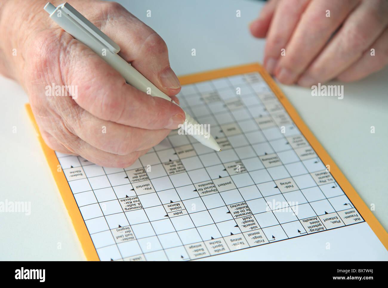 Crossword Puzzle Stock Photos & Crossword Puzzle Stock Images - Alamy