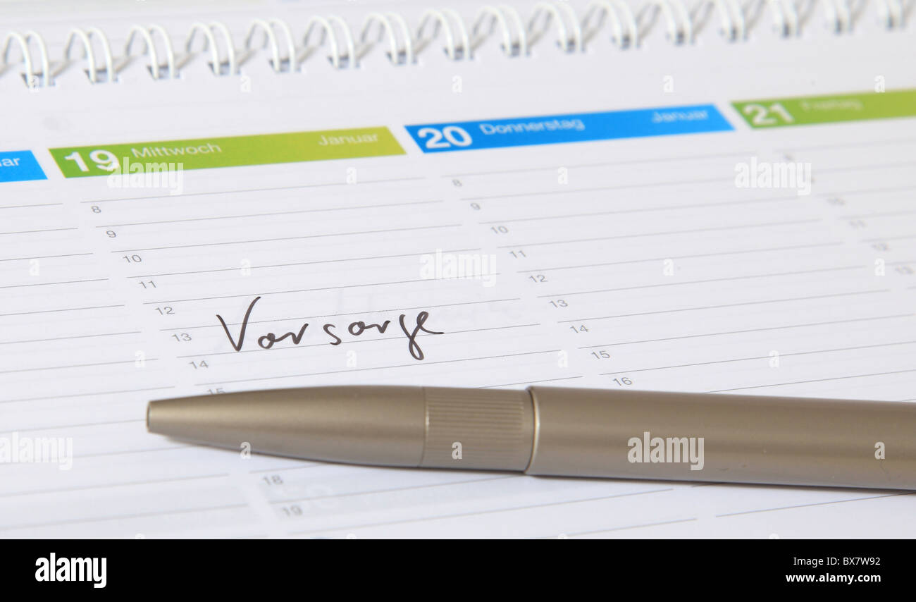 A calendar showing the german term Vorwarnung. english translation: precaution - Stock Image