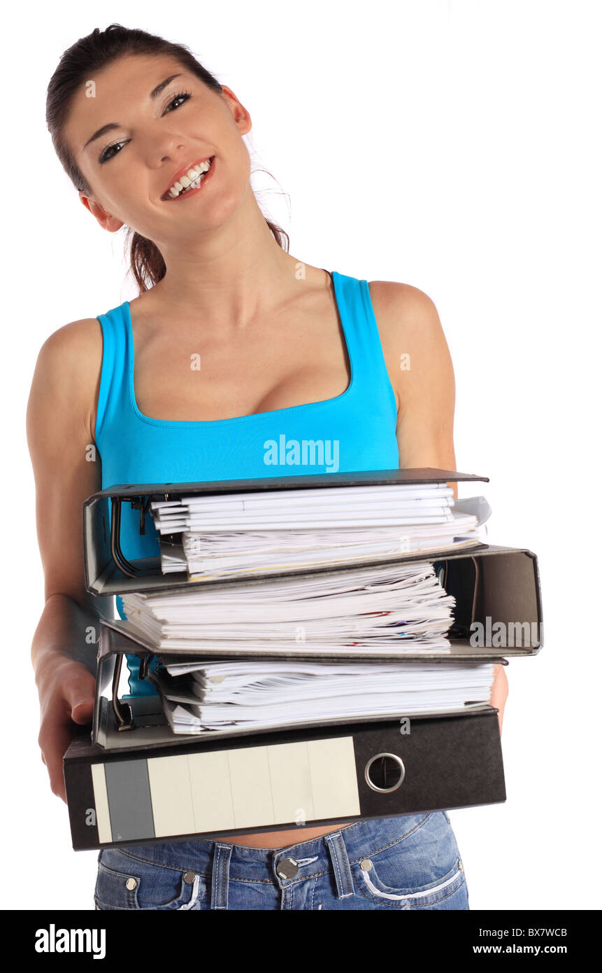 Attractive young woman carrying a pile of files. All on white background. - Stock Image