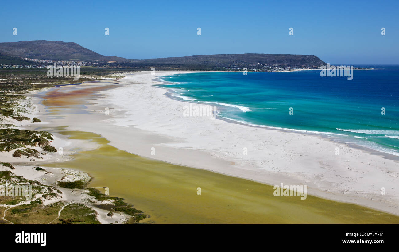 The expanse of Long Beach, with Kommetjie in the background, Cape Peninsula, South Africa. - Stock Image