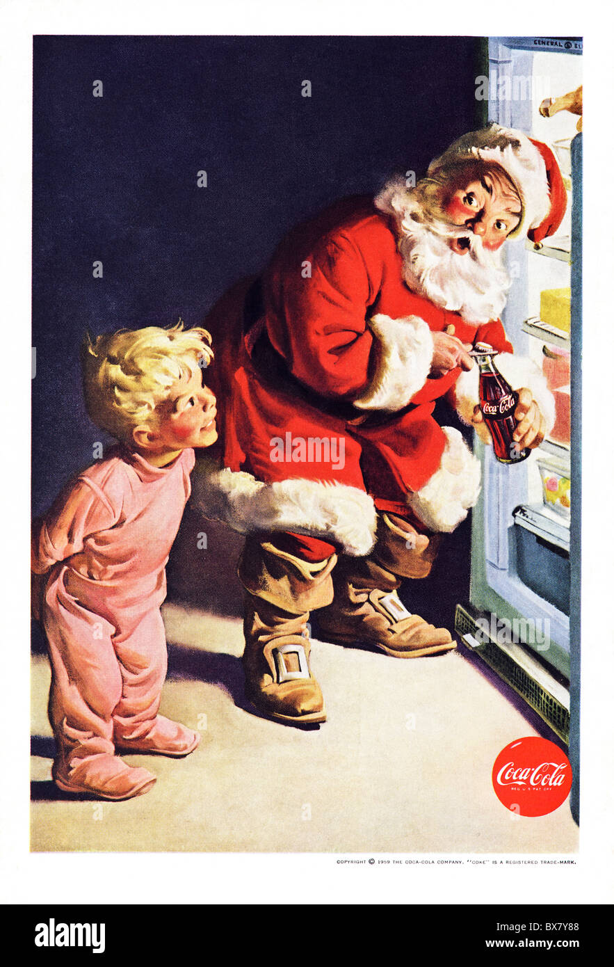 Classic Coca Cola advert in American magazine featuring colour illustration of Santa Father Christmas dated December - Stock Image
