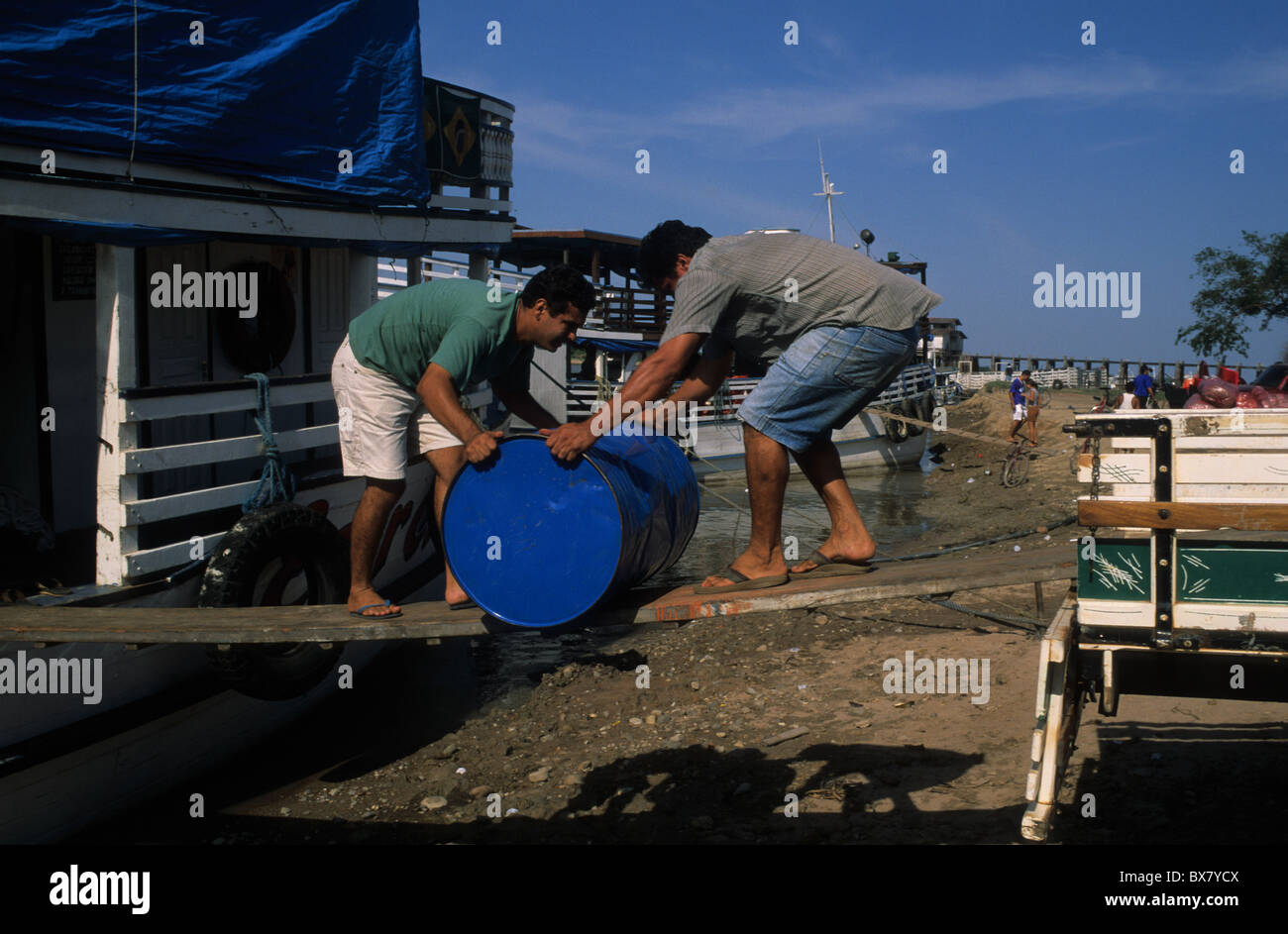 Men unloading a container ship in the Amazon river.ALENQUER State of Pará. BRAZIL (Amazon) Stock Photo
