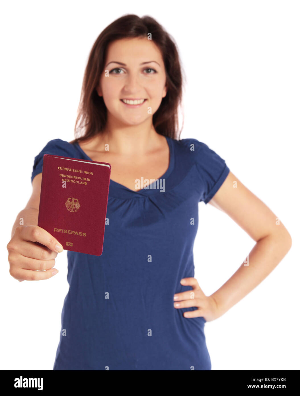 Attractive young woman holding a german passport. All isolated on white background. - Stock Image