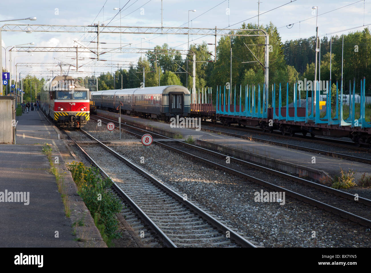Railway station where Intercity passenger trains are passing each other , Finland Stock Photo