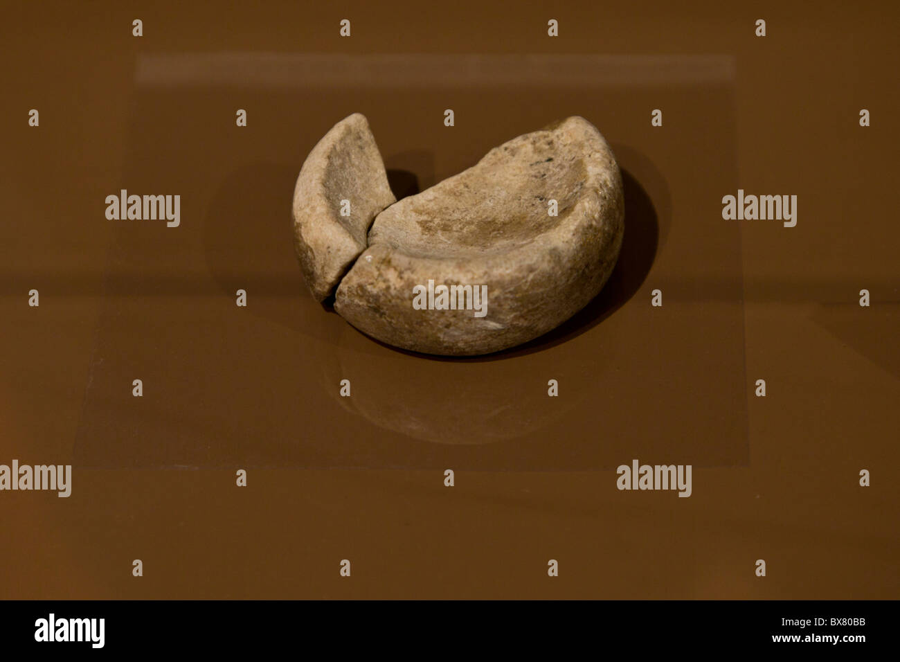 Stone discoidal used for the Native American game Chunkey at the Spiro Mounds Archeological Site Museum in Oklahoma, - Stock Image