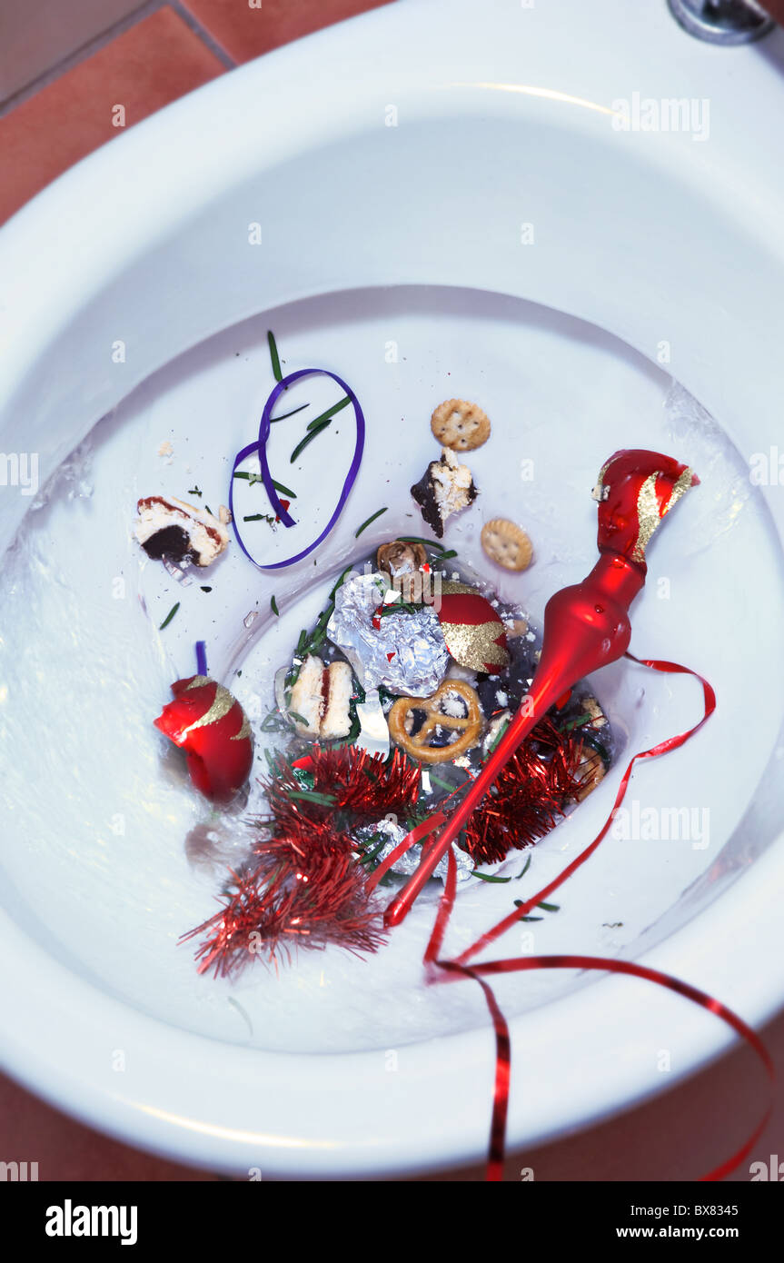 Ruined Christmas concept - Christmas mess in a toilet bowl. - Stock Image