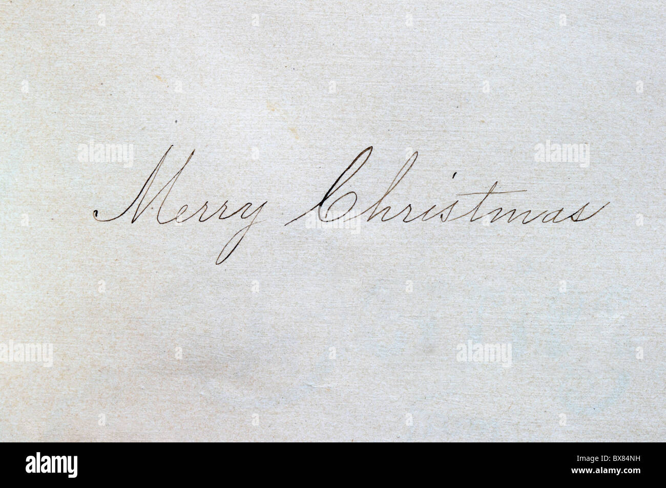 Merry Christmas In Cursive.Merry Christmas Written In Cursive Script On Paper With An