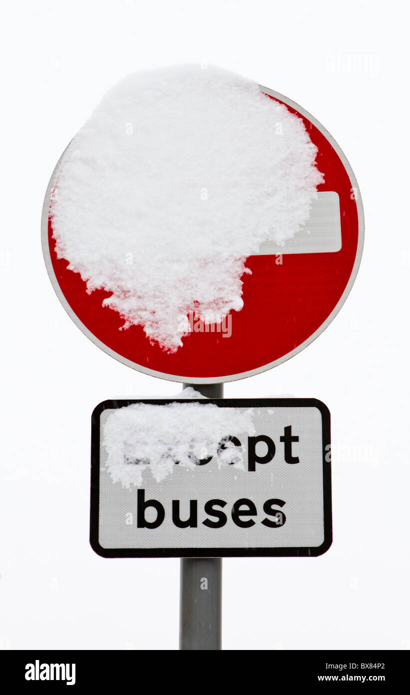Snow-covered 'No Entry' sign - Stock Image