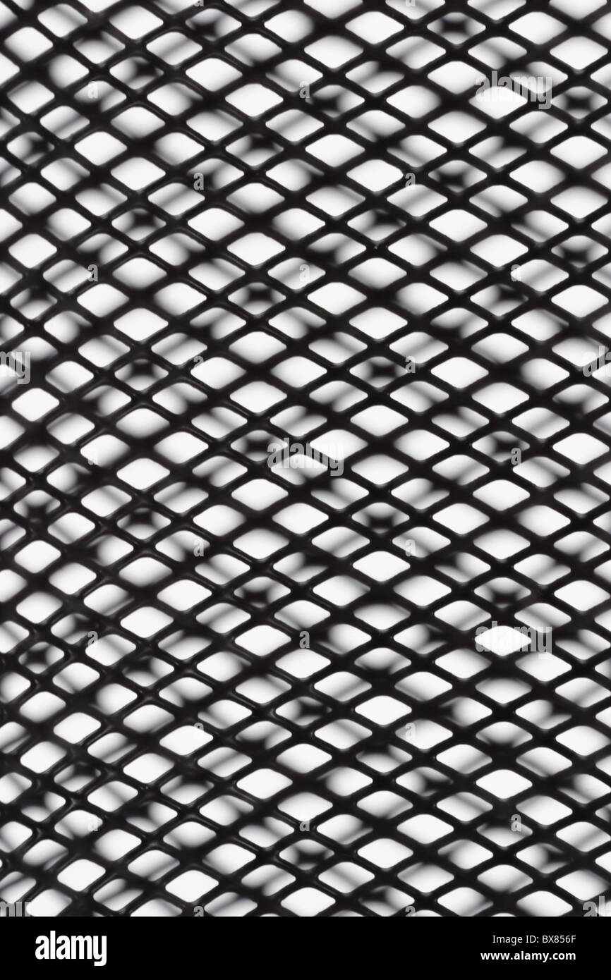 Abstract black wire mesh pattern with shadow on white background Stock Photo