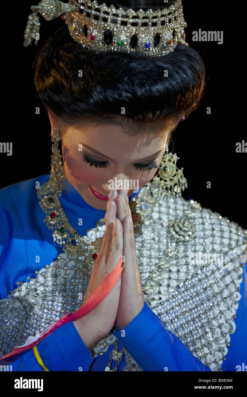 Beautiful Thai woman showing the traditional Thai greeting and salutation known as Wai. Thailand S. E. Asia - Stock Image